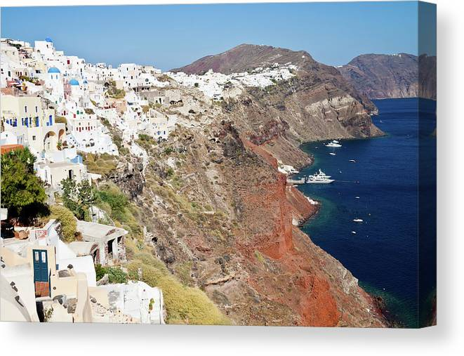 Tranquility Canvas Print featuring the photograph Rows Of Houses Perch On Cliff In Oia by Melissa Tse