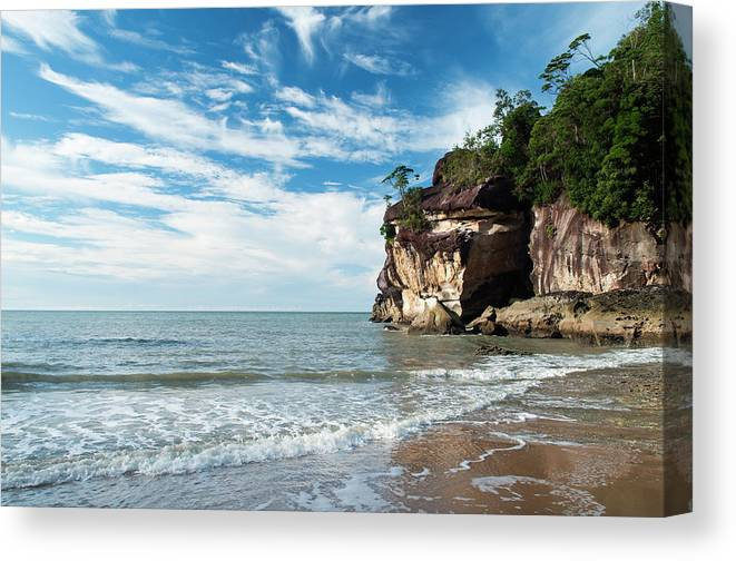 Scenics Canvas Print featuring the photograph Sandstone Cliffs By Ocean At Telok by Anders Blomqvist