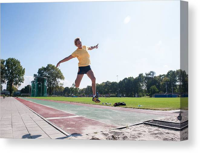 North Holland Canvas Print featuring the photograph Senior Athlete (75) Practicing Long Jump by Lucy Lambriex