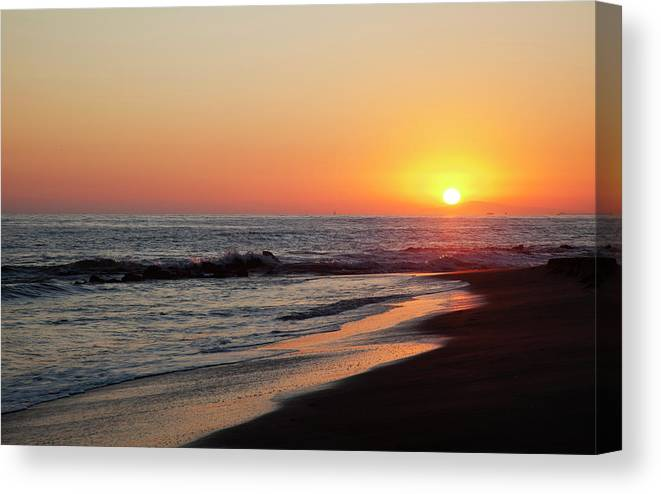 Scenics Canvas Print featuring the photograph Setting Sun On A Crystal Cove Beach by Driendl Group