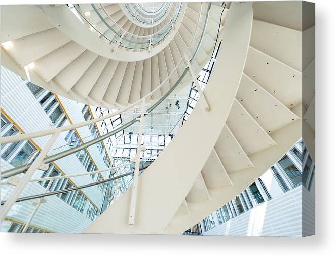Steps Canvas Print featuring the photograph Spiral Staircase Inside Office Complex by Blurra