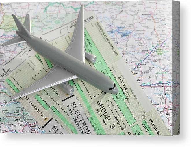 Airplane Canvas Print featuring the photograph Studio Shot Of Toy Airplane With by Vstock Llc