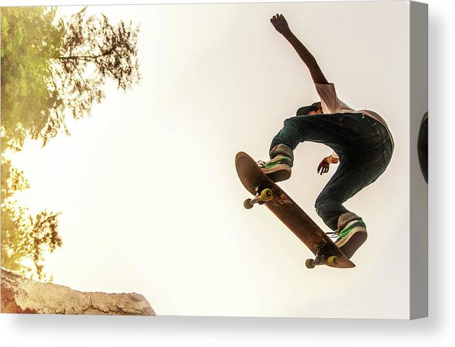 Child Canvas Print featuring the photograph Teenage Boy Performing Stunt On by @ Mariano Sayno / Husayno.com
