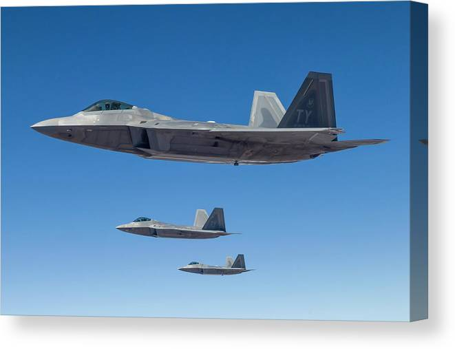 Formation Flying Canvas Print featuring the photograph Three U.s. Air Force F-22 Raptors by Rob Edgcumbe/stocktrek Images