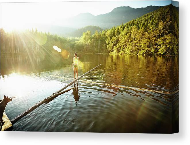 Pets Canvas Print featuring the photograph Woman Walking On Log In Alpine Lake by Thomas Barwick