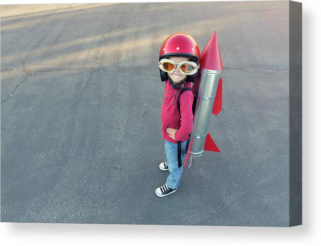 4-5 Years Canvas Print featuring the photograph Young Boy Dressed In A Red Rocket Suit by Richvintage