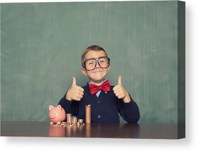 4-5 Years Canvas Print featuring the photograph Young Boy Nerd Saves Money in His Piggy Bank by RichVintage