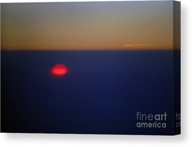 Sunset Canvas Print featuring the photograph Above the Sunset by Gib Martinez