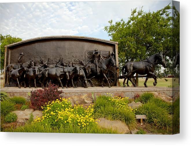 Landscape Canvas Print featuring the photograph Chisholm Trail Monument by Toni Hopper