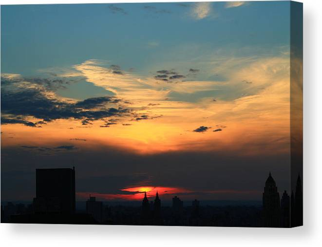 Sunset Canvas Print featuring the photograph In The Clouds by Catie Canetti