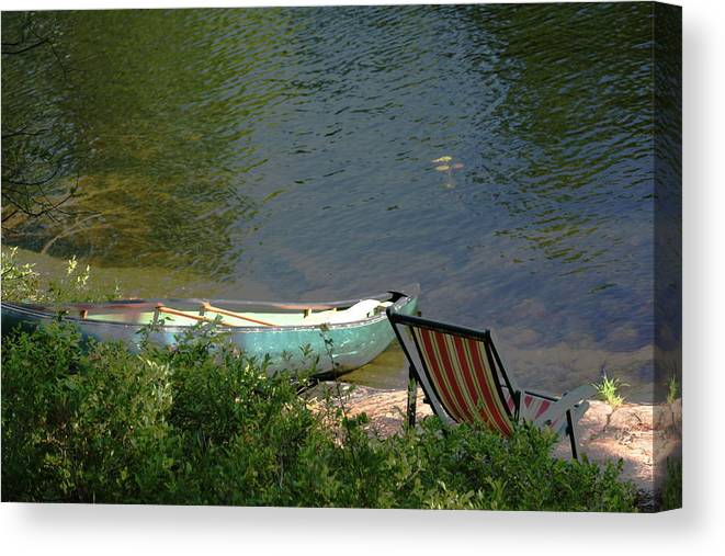 Water Canvas Print featuring the photograph Typical Canoe and Chair by Dr Carolyn Reinhart