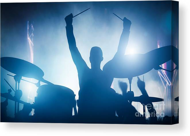 Drums Canvas Print featuring the photograph Drummer playing on drums on music concert. Club lights by Michal Bednarek