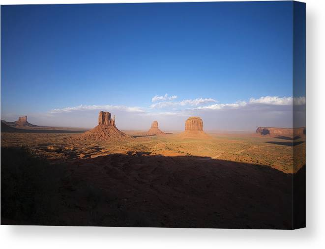 Monument Valley Canvas Print featuring the photograph As Evening Falls by Richard Henne