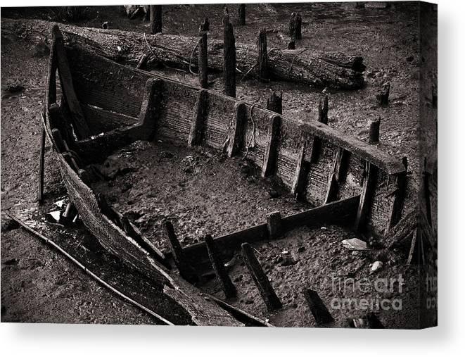 Abandon Canvas Print featuring the photograph Boat Remains by Carlos Caetano