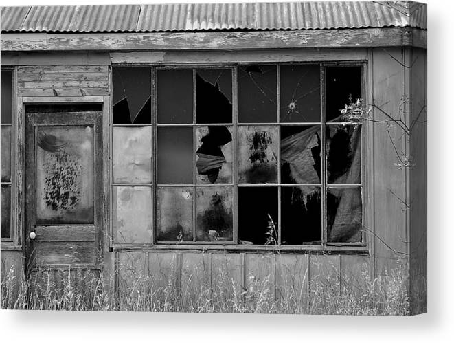 Broken Store Black White Canvas Print featuring the photograph Broken Store Front Black White by Kevin Mitts