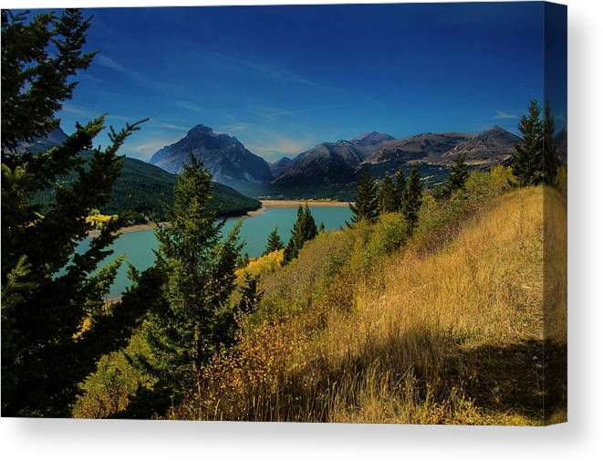 Lake Canvas Print featuring the photograph East Glacier Lake by Roy Nierdieck
