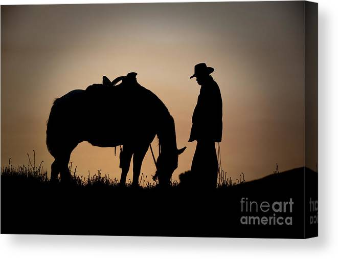 Cowboy And Horse Canvas Print featuring the photograph Going Home by Sandra Bronstein