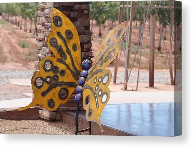 Metal Sculpture Canvas Print featuring the photograph Mustard Yellow Metal Sculpture of Butterfly by Colleen Cornelius
