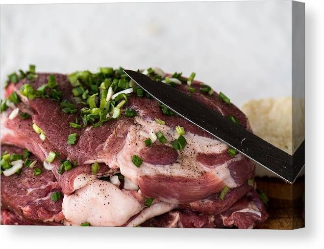 Background Canvas Print featuring the photograph Pork meat with green garlik and knife by Adrian Bud