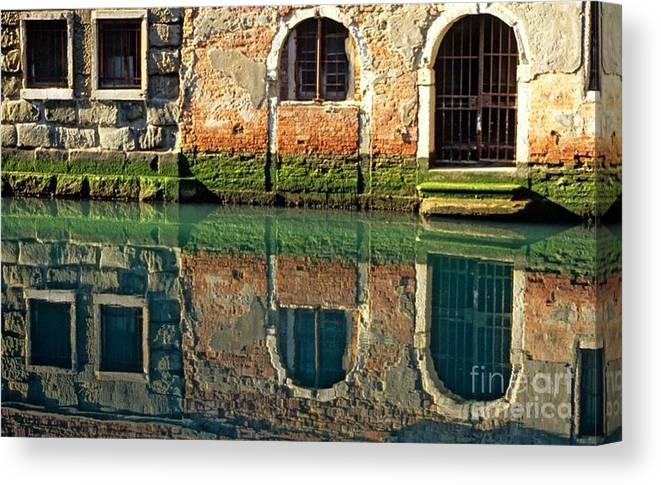 Venice Canvas Print featuring the photograph Reflection on Canal in Venice by Michael Henderson