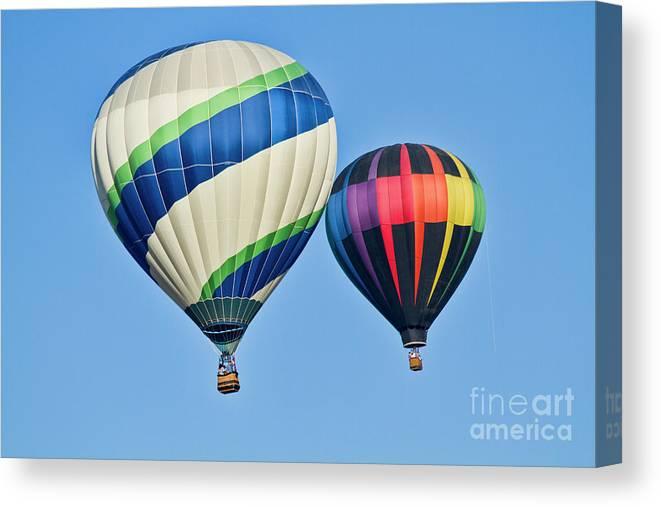 Hot Air Ballons Canvas Print featuring the photograph Rising High by Arthur Bohlmann