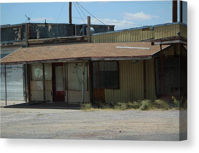 Abandoned Building Canvas Print featuring the photograph Rustic Abandoned Building on the Road in New Mexico by Colleen Cornelius