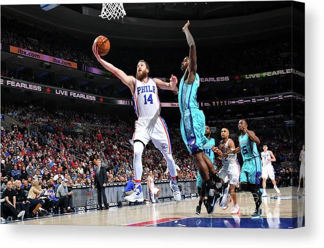 Nba Pro Basketball Canvas Print featuring the photograph Charlotte Hornets V Philadelphia 76ers by Jesse D. Garrabrant