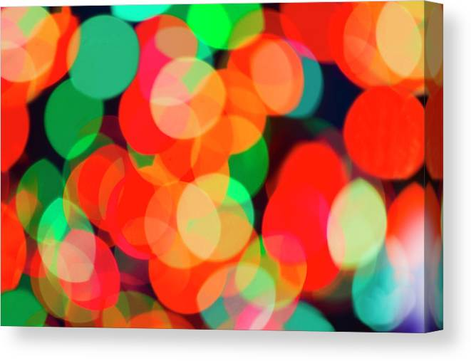 Holiday Canvas Print featuring the photograph Defocused Lights by Tetra Images