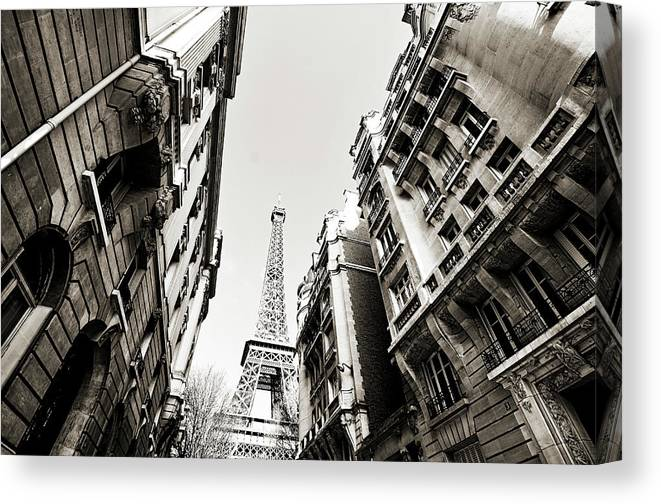 Built Structure Canvas Print featuring the photograph Eiffel Tower Between Buildings In by Flory