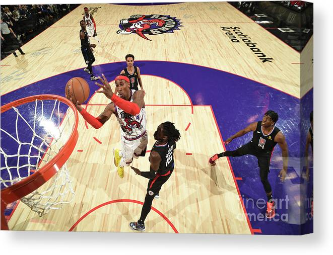 Nba Pro Basketball Canvas Print featuring the photograph La Clippers V Toronto Raptors by Ron Turenne