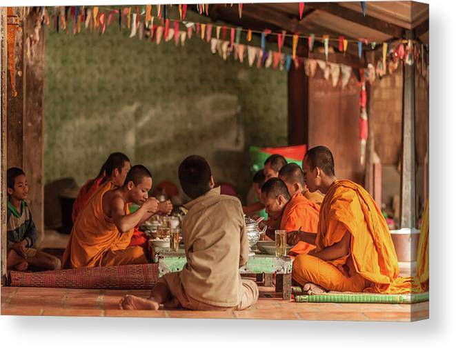 Young Men Canvas Print featuring the photograph Monks At Breakfast, Wat Monastery by Cultura Rm Exclusive/gary Latham