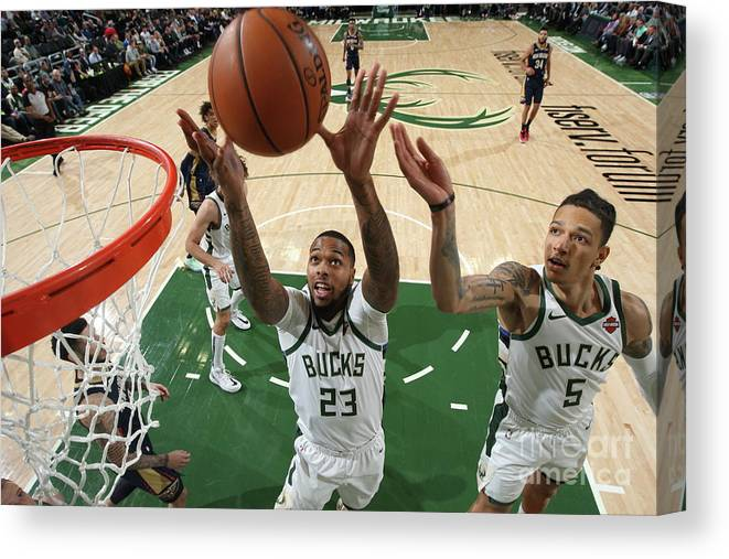 Nba Pro Basketball Canvas Print featuring the photograph New Orleans Pelicans V Milwaukee Bucks by Gary Dineen