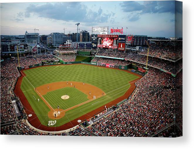 American League Baseball Canvas Print featuring the photograph New York Mets V Washington Nationals by Rob Carr