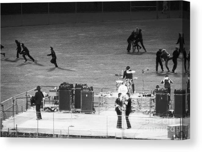 Candlestick Park Canvas Print featuring the photograph The Beatles In Concert by Bettmann