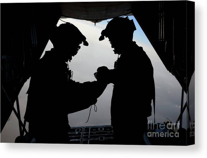 People Canvas Print featuring the photograph U.s. Air Force Loadmasters Fold by Stocktrek Images
