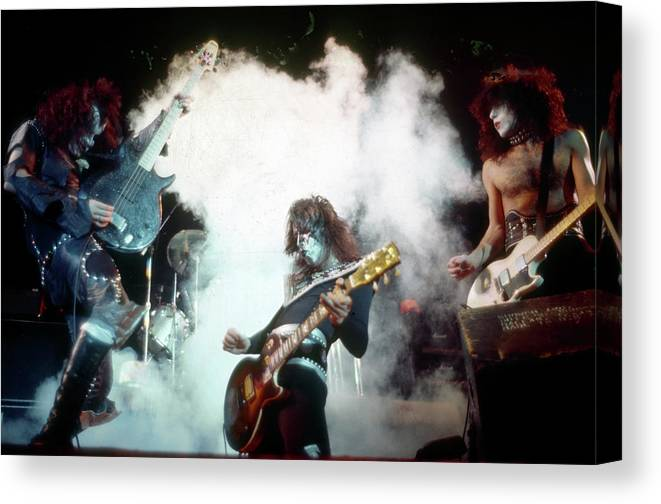 Rock Music Canvas Print featuring the photograph Kiss Performing by Michael Ochs Archives