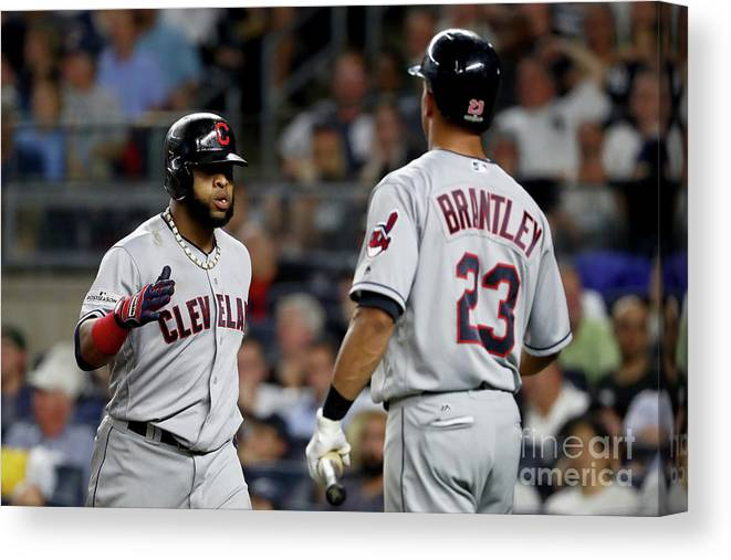 Three Quarter Length Canvas Print featuring the photograph Divisional Round - Cleveland Indians V by Al Bello
