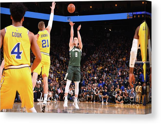 Nba Pro Basketball Canvas Print featuring the photograph Milwaukee Bucks V Golden State Warriors by Noah Graham