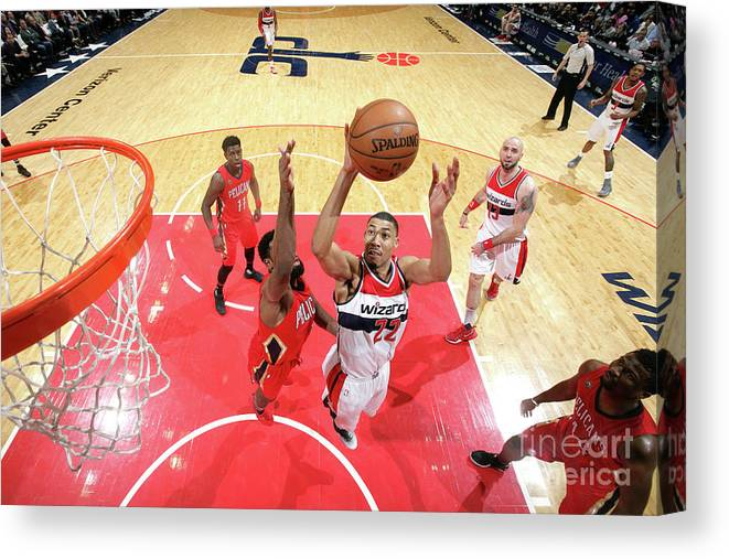Nba Pro Basketball Canvas Print featuring the photograph New Orleans Pelicans V Washington by Ned Dishman
