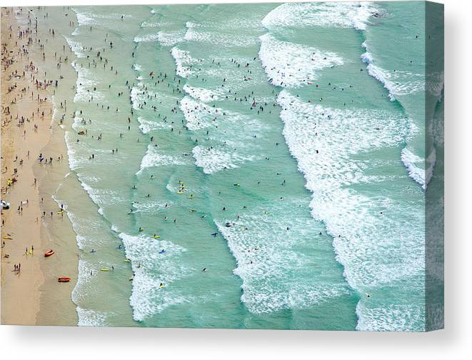 Water's Edge Canvas Print featuring the photograph Swimmers And Surfers On Beach, Aerial by Jason Hawkes