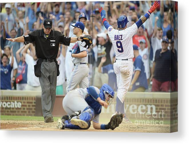 People Canvas Print featuring the photograph Toronto Blue Jays V Chicago Cubs by Stacy Revere