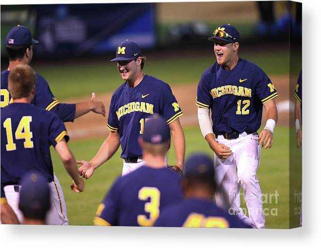 Working Canvas Print featuring the photograph Michigan V Ucla - Game One by Jayne Kamin-oncea