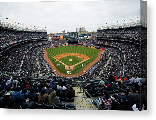 East Canvas Print featuring the photograph Baltimore Orioles V. New York Yankees by Rob Tringali