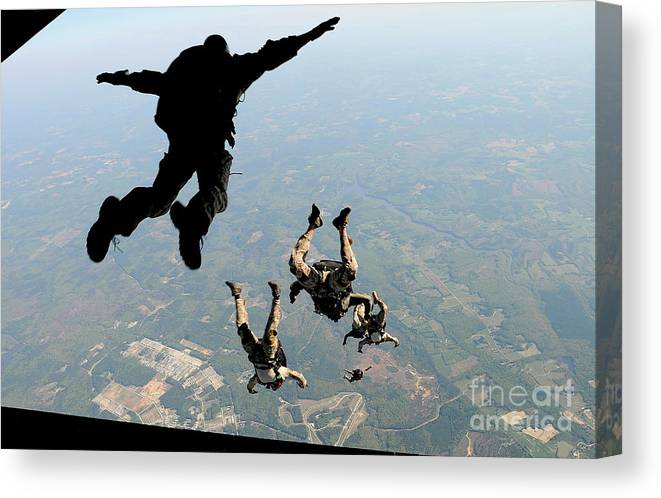 People Canvas Print featuring the photograph Navy Seals Jump From The Ramp Of A C-17 by Stocktrek Images