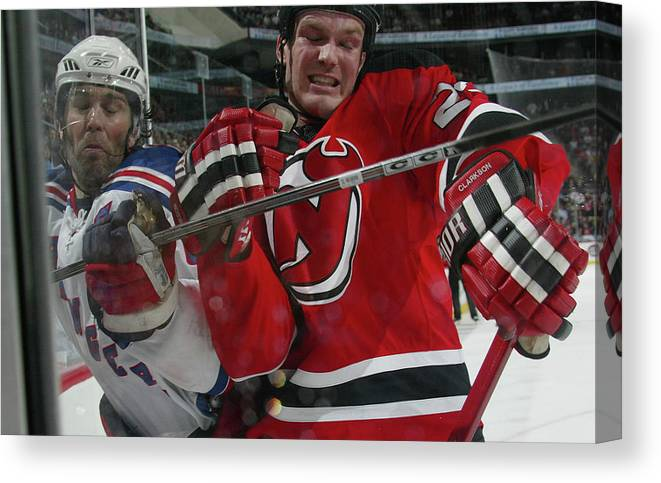 David Clarkson Canvas Print featuring the photograph New York Rangers V New Jersey Devils by Bruce Bennett