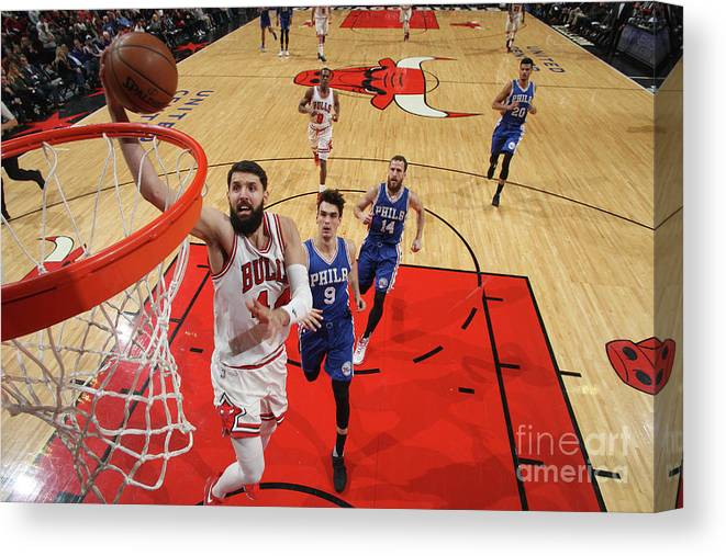 Nba Pro Basketball Canvas Print featuring the photograph Philadelphia 76ers V Chicago Bulls by Gary Dineen