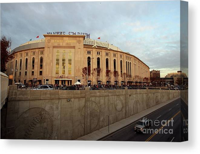 Game Two Canvas Print featuring the photograph Philadelphia Phillies V New York by Jed Jacobsohn