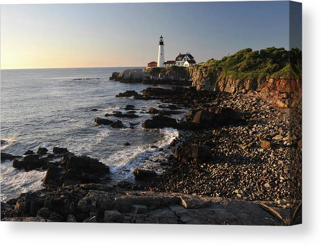 Water's Edge Canvas Print featuring the photograph Portland Head Light by Aimintang