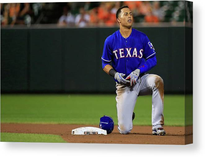 American League Baseball Canvas Print featuring the photograph Texas Rangers V Baltimore Orioles by Rob Carr