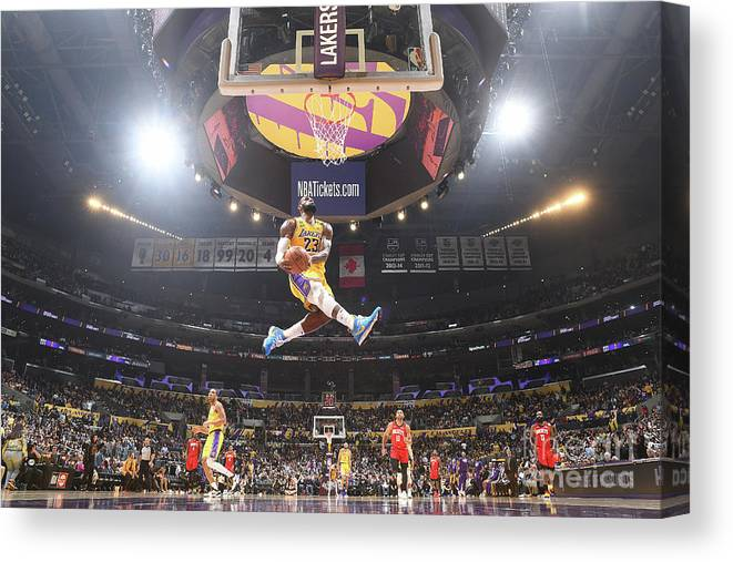 Nba Pro Basketball Canvas Print featuring the photograph Lebron James Double-Clutch Reverse Dunk Tribute to Kobe Bryant by Andrew D. Bernstein